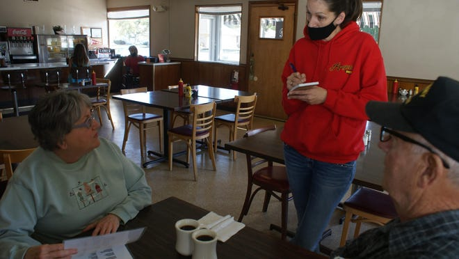Rogers Diner co-owner Melanie Rogers waits on patrons Wanda and Frank Sanders of Pekin.