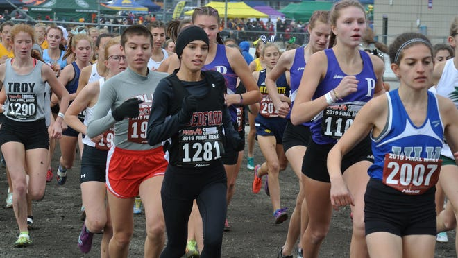Bedford's Isabella Johnson (1281) runs in the Division 1 state cross country finals at Michigan International Speedway.