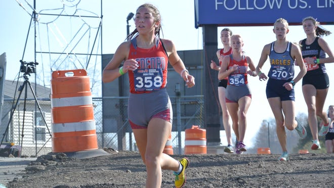 Lauren Sancrant of Bedford runs through a construction zone at the State Cross Country Finals at Michigan International Speedway.