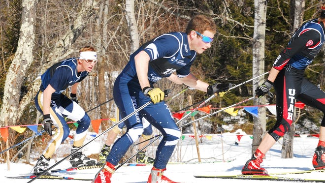 Ben Lustgarten (center) shown when he was a member of the Middlebury College Nordic ski team.