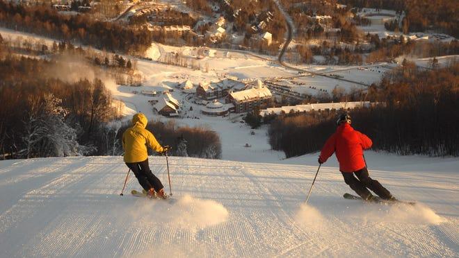 Two skiers rip down Spring Fling at Sugarbush.