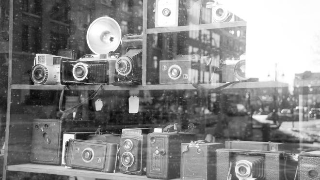 One of Howard Rigden's photos focuses on the cameras in the store window and the reflection in the window's glass, showing, in part, what the cameras can see.