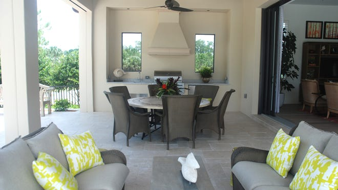 The outdoor area in the Annalisa model feature a table, seating area and a mini kitchen.