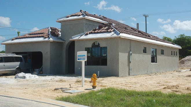 Construction is underway at Estero Place where model homes, spec homes and newly purchased homes are being built.