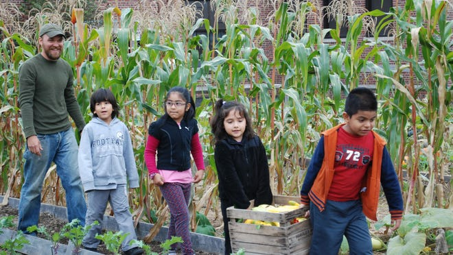 Children learn the basics of planting and nutrition at Grow It Green's Urban Farm, located at the Lafayette Learning Center in Morristown.