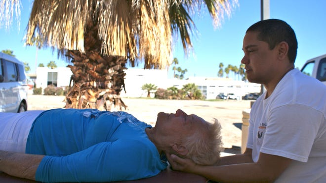Daniel Lopez massages Bette Jayne Haak, a Palm Springs snowbird from Minnesota. Haak suffers from arthritis and gets several massages a month.