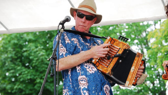 Mike Palms, of the band Creole du Nord, plays the accordion and sings during Thumbfest 2013 in Lexington.
