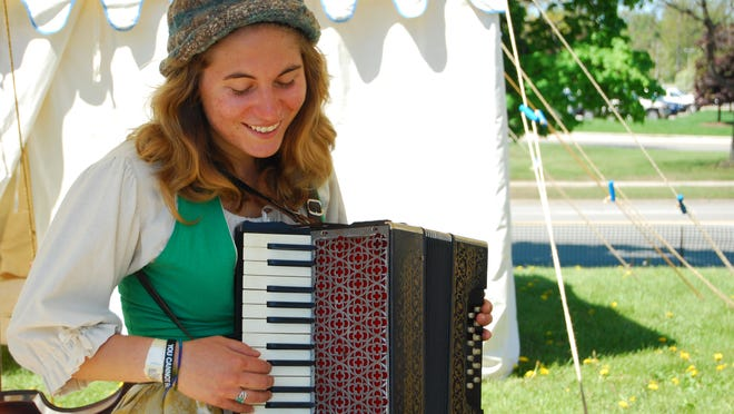 Shaana Way, from Kalamazoo, plays the accordion at the Feast of the Ste. Claire at Pine Grove Park in Port Huron.