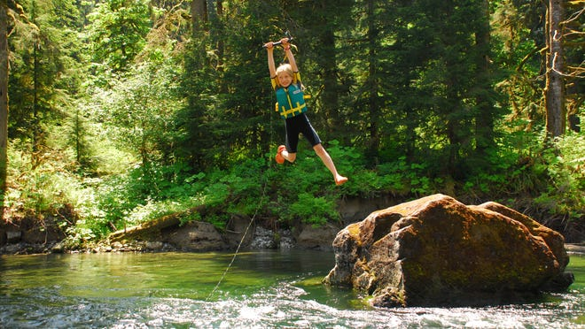 Rylie Shaeffer swings into Washington's Middle Fork Snoqualmie River, which would be protected under the Wild and Scenic Rivers Act if a package of bills passed by Congress last week is signed by President Obama.