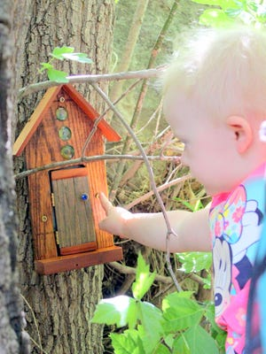 Ammelia Cherry, 2, says hello at one of the tiny homes.