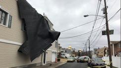 High winds ripped off the rubberized roof of a mixed-use