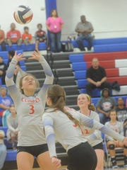 Cooper's Pearce Bjorlie (3) sets the ball for a teammate against Lubbock Monterey. Cooper beat the Lady Plainsmen 25-18, 26-28, 25-21, 24-26, 16-14 in the District 4-5A match Tuesday, Sept. 26, 2017 at Cougar Gym.