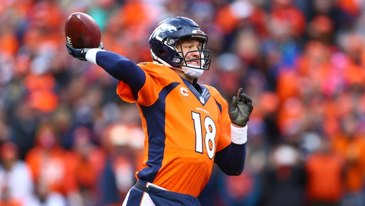 Denver Broncos quarterback Peyton Manning (18) drops back to pass against the New England Patriots in the second half in the AFC Championship football game at Sports Authority Field at Mile High.