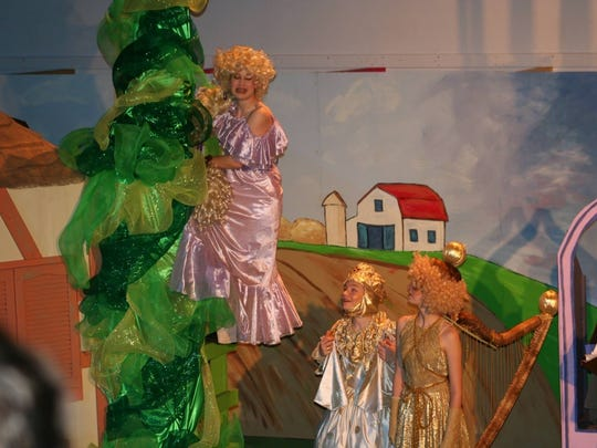 Rapunzel (Anna Jane Storms) gets her hair stuck in the beanstalk while the Golden Goose (Arielle Douthit) and Harpo (Emalie Dickey) look on.