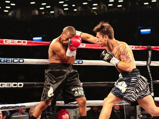 Dustin Fleischer (right) connects against Kareem Millner on Satuday night at the Barclays Center in Brooklyn.