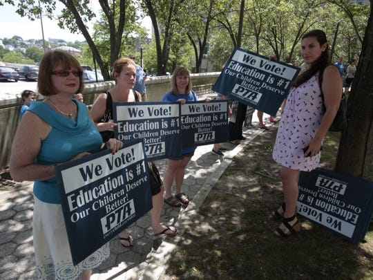 Groups have gathered Sunday outside Yonkers City Hall in anticipation of an announcement by Gov. Andrew Cuomo.