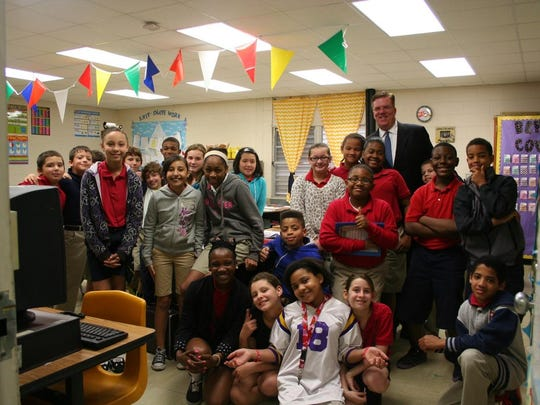 Boyd Craig, chairman and CEO of I Am A Leader Foundation, visits with students at Carencro Heights Elementary in 2013. The school uses The Leader in Me.