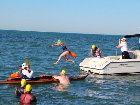 Jenny Birmelin jumps off the boat into Lake St. Clair on July 30 for the Swimming St. Clair charity swim.