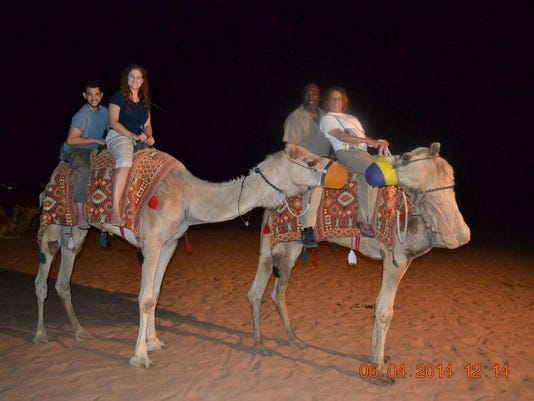 York College students and staff wrote camels during a stop in Dubai. (Submitted)