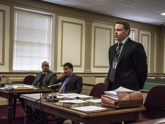 From left, Andrew Pfitzenmayer sentenced for bringing two handguns into Headquarters Plaza in Morristown on July 29, 2015, sits with his defense lawyer Frank Pisano as Morris County Assistant Prosecutor Joseph Napurano argues for prison time.