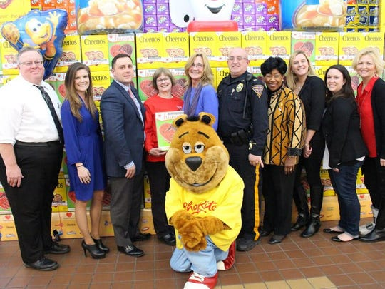 Pictured at the Somers Point of ShopRite Cheerios box unveiling are Bob Wode, Village Super Market district manager; Caitlin Broscius, Village Super Market Marketing Department; store owner family member Perry Blatt; Mary Hill, associate on the box; Nancy Mahoney, store manager; Lt. Anthony DiSciascio, Somers Point Police Department; Orien Reid, ShopRite spokesperson; Amanda Forshaw and Kate Simmermon, Somers Point Police Department; and Collete Kraus, Community Food Bank of NJ, Southern Branch.