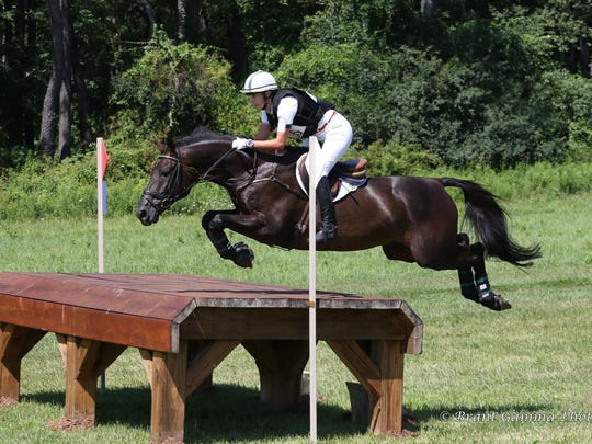 Murphy Kozumplik and his horse Catchascatchcan is shown at a past event in Millbrook.