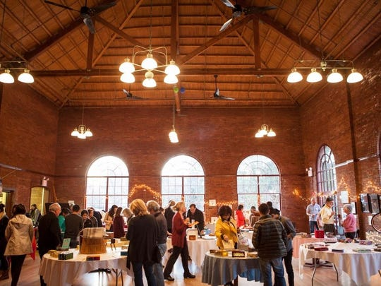 Last year's Artists for Soup fundraiser is shown at Vassar College's AULA building.