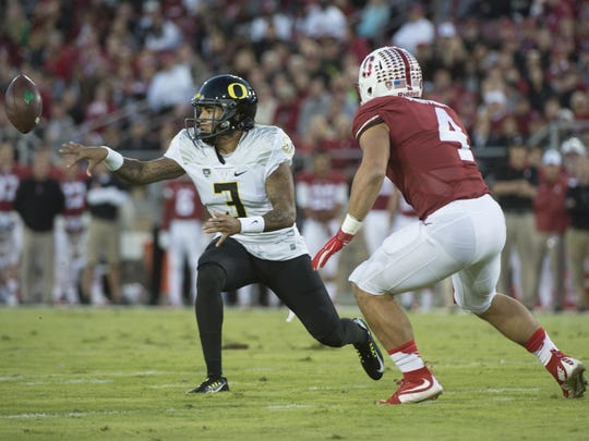 November 14, 2015; Stanford, CA, USA; Oregon Ducks quarterback Vernon Adams Jr. (3) passes the football against Stanford Cardinal linebacker Blake Martinez (4) during the first quarter at Stanford Stadium. Mandatory Credit: Kyle Terada-USA TODAY Sports