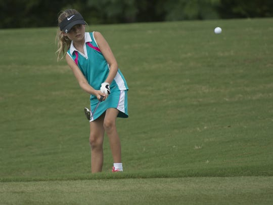 Islay Benoit watches the flight of her chip shot to the green during a playoff in the 2015 Downing Gray Cup. Benoit, 12, claimed three wins on the local GPJGA Summer Tour in 2019.