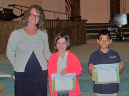 Imago Dei Academy Headmaster Laura King, BUG students honored Ansley Cooler and Aaron Blaylock.  Jayden Vazquez and Patrick Barnes were unavailable for the picture.