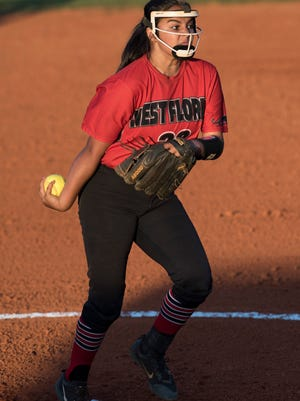 West Florida's Jeya Prasad delivers her opening pitches against Green Cove Springs-Clay High during Friday night's Region 1-6A championships. Early fielding troubles and silent bats cost the Jags.