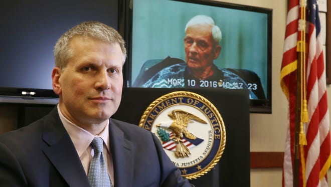 Assistant U.S. Attorney John Field, left, with videotaped deposition of Henry Jessen, the victim in a Jamaican lottery fraud scam, at the Federal Building in Rochester on Jan. 19, 2017.
