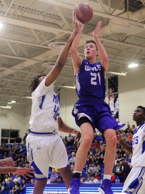 Wylie's Dylan Isenhower (21) gets fouled by Lubbock Estacado's Larry Morrison (42) during the Bulldogs' 74-70 win in the Region I-4A semifinals at the Lubbock Christian University Rip Griffin Center on March 2, 2018.
