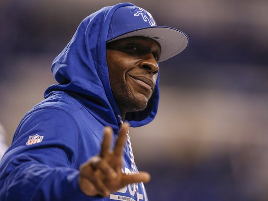 Injured Indianapolis Colts outside linebacker Robert Mathis (98) waves to fans along the sideline during pregame warmups before the Colts face off against the Houston Texans at Lucas Oil Stadium on Sunday, Dec. 11, 2016.