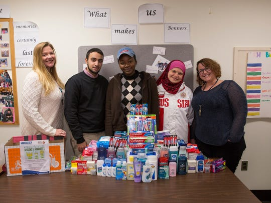 The Middlesex County College service learning program, Democracy House, recently held a drive to collect personal hygiene items to be donated to Elijah's Promise, the soup kitchen in New Brunswick. Called Hygiene for Humanity, the drive resulted in more than 100 items going to Elijah's. From left, Pattiann McMahon, faculty advisor to Democracy House; Hamzah Ghani of North Brunswick, president; Arame Toure of  Edison; Katsiaryna  Sikorskaya of East Brunswick; and Taylor Rotolo of Somerset, the coordinator.