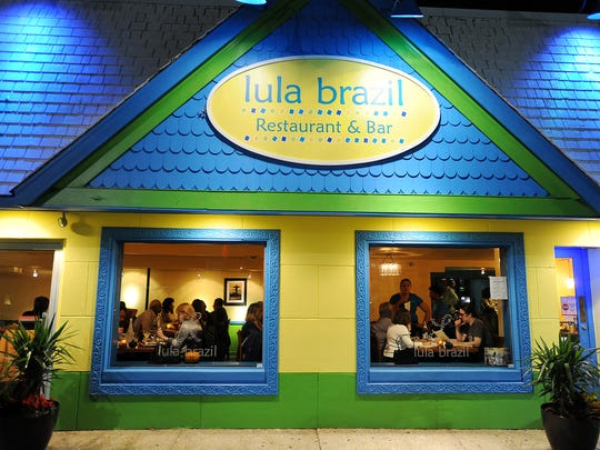 Diners enjoy dinner through the window at Lula Brazil in Rehoboth Beach. The restaurant is closing for good on Jan. 1.