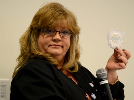 Pam Cooper holds up a diaper worn by premature babies at Jackson-Madison County General Hospital Neonatal Intensive Care Unit. The kickoff for the March of Dimes' March for Babies was held Thursday afternoon.