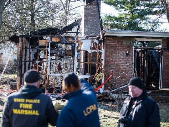 The Pennsylvania State Police Fire Marshal and Lebanon County Fire Marshal investigate a fire after fire crews battled a house fire at 310 Quittie Park Drive in South Annville Township early morning on Saturday, March 4, 2017. This was the second time in fewer than 24 hours that fire crews were called to a fire at 310 Quittie Park Drive. Crews were dispatched around 1 p.m. on Friday, March 3, for a dwelling fire, too.