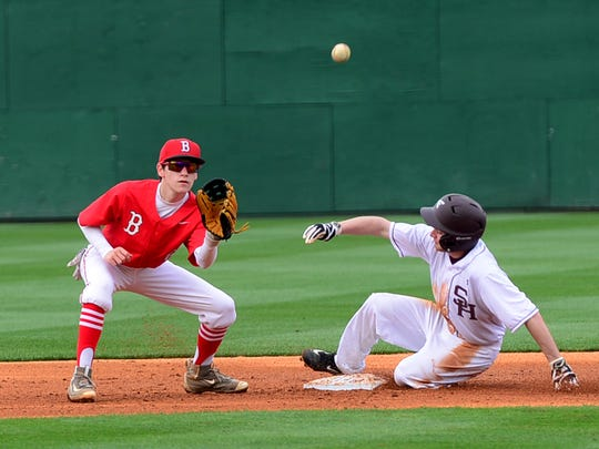 Sacred Heart's Luke Singleton slides safely to second base before Bradford's Hunter Avery can make the catch and tag during their game, Friday evening at The Ballpark at Jackson. Sacred Heart defeated Bradford, 10-1.