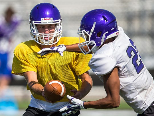 Senior Kyle Strakis passes the ball off during practice at Brownsburg High School, Indianapolis, Tuesday, August 8, 2017. Strakis will start as quarterback for Brownsburg High School this fall, a position previously held by 2016-2017 Mr. Football Hunter Johnson.