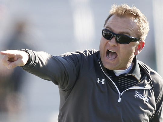 Towson coach Rob Ambrose yells at officials in the fourth quarter of Towson's 24-17 win at Delaware Stadium in 2014.