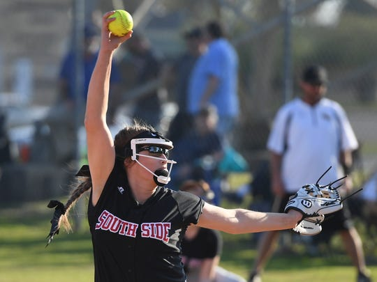 South Side's Kayla Beaver winds back for a pitch during Thursday's game against Scotts Hill. South Side defeated Scotts Hill, 4-0.