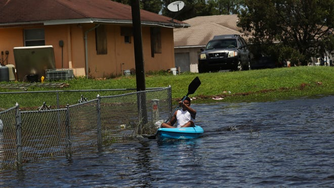 Standing water like this from Hurricane Irma in Lehigh Acres can contaminate private wells. After the hurricane, the health department offered free bacterial testing for Lee County residents on private wells.