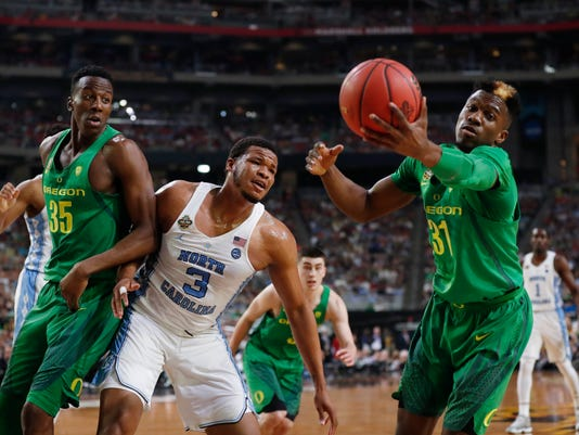 Oregon guard Dylan Ennis, right, grabs a rebound in front of North Carolina forward Kennedy Meeks (3) during the first half in the semifinals of the Final Four NCAA college basketball tournament, Saturday, April 1, 2017, in Glendale, Ariz. (AP Photo/Charlie Neibergall)
