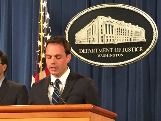 Ben Mizer of the Department of Justice speaks at the