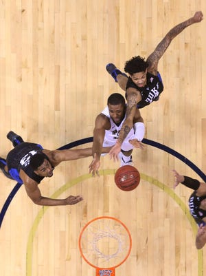 Duke Blue Devils guard Matt Jones (13) and guard Derryck Thornton (12) reach for a rebound against Pittsburgh Panthers forward Sheldon Jeter (middle) during the second half at the Petersen Events Center. PITT won 76-62.