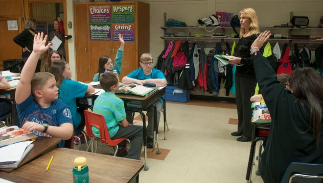 Substitute teacher Lee Anne Sawvel asks students to read out loud to their fellow students from their text books Wednesday, March 16 at Michigamme Elementary School in Port Huron Township. Sawvel is teaching fifth grade for Terry Roles' class. Michigamme Elementary School has been removed from the state's Focus schools list.