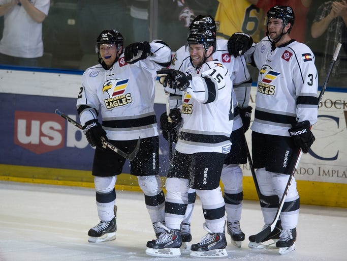 From left, Riley Nelson, Kyle Kraemer and Mark Nemec celebrate Kraemer's goal during game 3 of a playoffs series against the Idaho Steelheads at the Budweiser Event Center in Loveland Tuesday, April 22, 2014. A last-minute empty-net goal took the Eagles to a 4-1 victory over the Steelheads and the series is now at 2-1 Eagles.