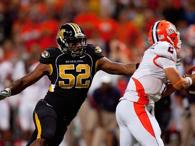 ST. LOUIS - SEPTEMBER 4: Michael Sam #52 of the University of Missouri Tigers looks to sack Nathan Scheelhaase #2 of the University of Illinois Fighting Illini during the State Farm Arch Rivalry game on September 4, 2010 at the Edward Jones Dome in St. Louis, Missouri. The Tigers defeated the Fighting Illini 23-13.  (Photo by Dilip Vishwanat/Getty Images)