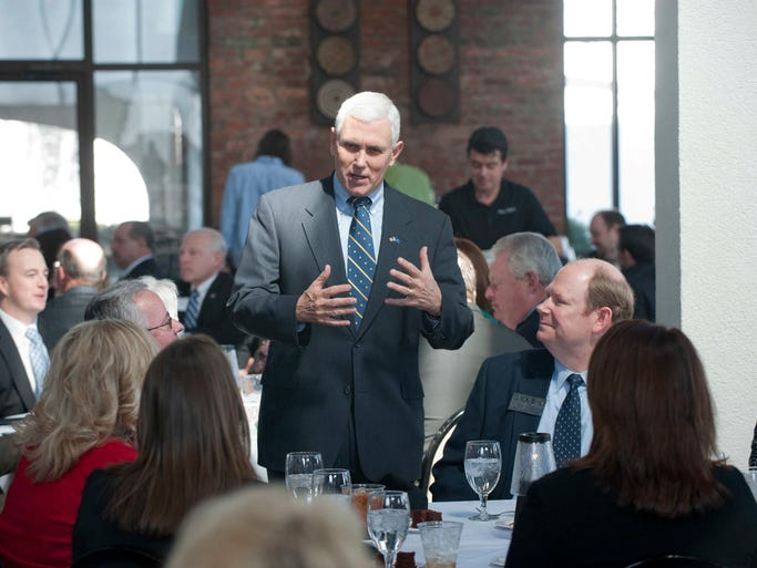 Indiana Governor Mike Pence visits with leaders of the community before speaking at the Leadership Southern Indiana Governor's Series Luncheon held at Kye's. March 05, 2014
